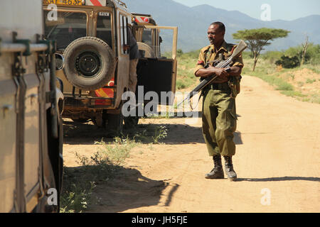 LOIYANGELENI, KENYA - May 21. An armed solider on guard of a tourism convoy on the road from Loyangalani to Isiolo - Stock Image