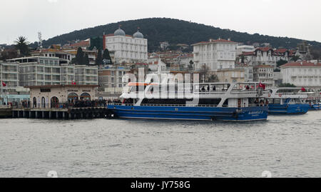 Istanbul, Turkey - March 3, 2013: Buyukada (Princess Island) Ferry Terminal with passengers riding a ferry and summer - Stock Image