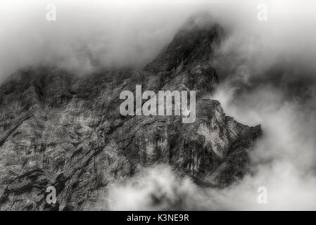 Clouds on the summit of the mountains, dangerous for mountaineers - Trentino-Alto Adige - Stock Image