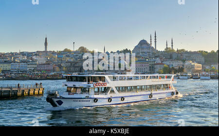 Istanbul, Turkey - April 25, 2017: City view of Istanbul, Turkey from the sea overlooking a passing ferry with Eminonu - Stock Image