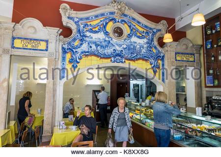 Portugal Lisbon Rato Pastelaria 1800 bakery cafe historic building interior counter Art Nouveau azulejos painted - Stock Image