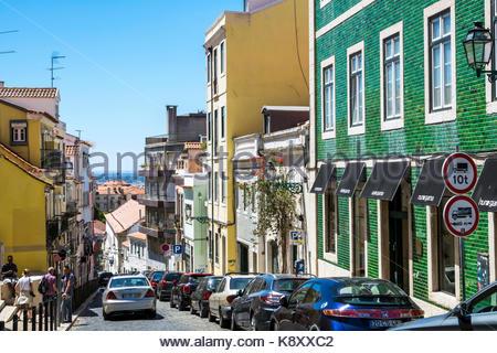 Portugal Lisbon Bairro Alto historic district Principe Real buildings descending street parked cars buildings azulejos - Stock Image