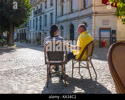 Couple at café table, Chinon, France. - Stock Image