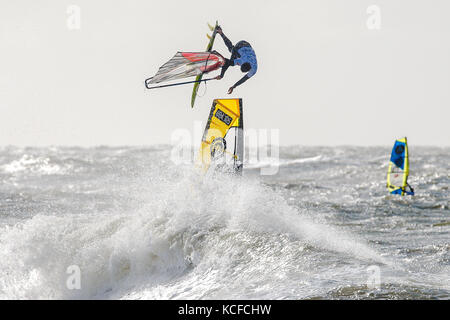 Westerland, Germany, 5th October 2017: Spanish windsurfer Victor Fernandez (E42) defeats Marcilio Browne to win - Stock Image