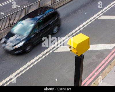 A car speeding through a speed trap in London - Stock Image
