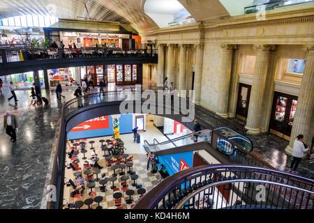 Washington DC District of Columbia Union Station railroad train terminal food court mezzanine escalator interior - Stock Image