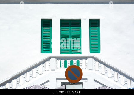 Traditional green window shutters over whitewashed facade, Tangier, Morocco - Stock Image