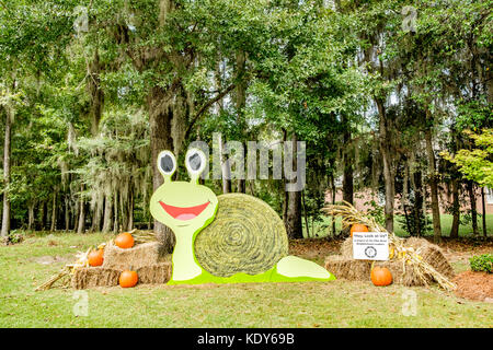 Hay roll decorated for the American Halloween holiday in Pike Road, Alabama USA. - Stock Image