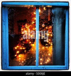 Christmas tree through a window - Stock Image