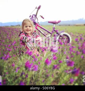 Young girl in flowery field - Stock Image