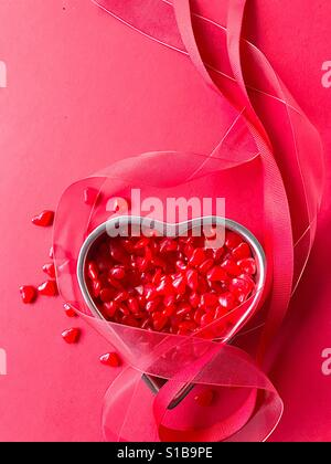 Red heart candy with ribbons vertical - Stock-Bilder