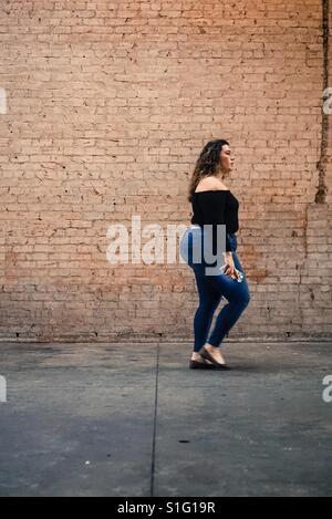 Walking down the street - Stock-Bilder
