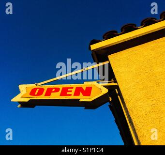 Open sign on blue background in route 66 USA - Stock Image