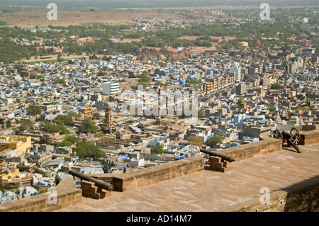 Horizontal elevated view over the city of Jodhpur from the Mehrangarth Fort with houses painted blue in the distance. - Stock Image