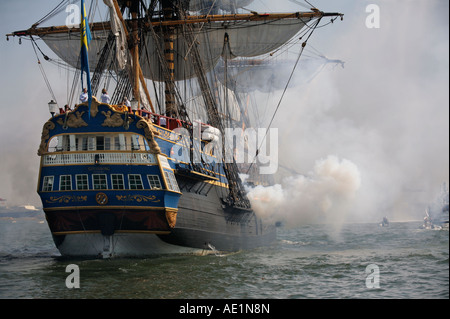 Cannon gun salute- Replica of East Indiaman Gothenburg the largest ship of its kind internationally certified for - Stock Image
