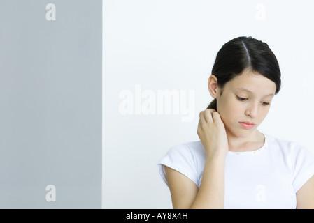detail photo preteen girl doing homework twirling strand hair royalty free image