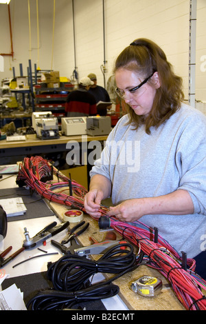 chassis stock photos chassis stock images alamy female worker wiring harness assembly at spartan motors truck chassis manufacturing in charlotte michigan