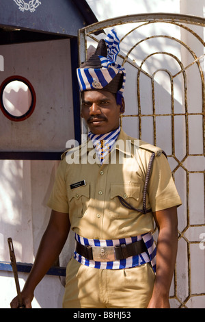 India Pondicherry armed policeman in formal dress uniform guarding police station - Stock Image