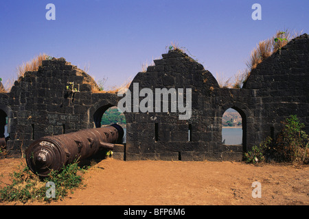Cannon in hole and fortifications of Janjira fort ; Murud ; Maharashtra ; India - Stock Image