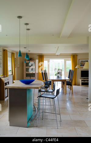 Open Plan Kitchen With Barstools Turquoise Pendant Lights And French Windows