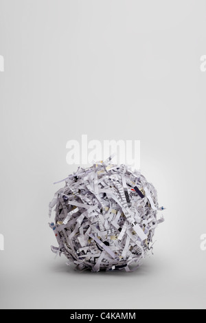 a-ball-of-shredded-paper-on-a-light-grey