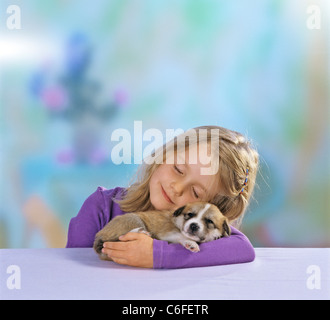 Canoodling Stock s & Canoodling Stock Alamy #2: girl with half breed dog puppy 21 days in arm c6fetr
