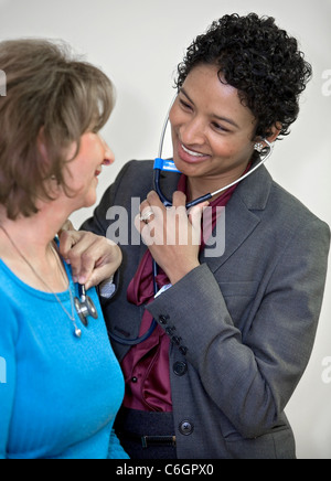 a-doctor-examines-a-patient-in-her-exami