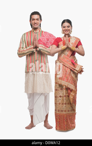 a92602c8f0 Portrait of a couple greeting in traditional clothing - Stock Image