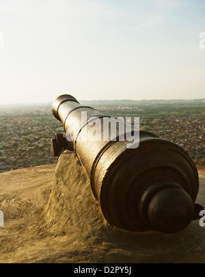 Cannon in a fort with cityscape, Nahargarh Fort, Jaipur, Rajasthan, India - Stock Image