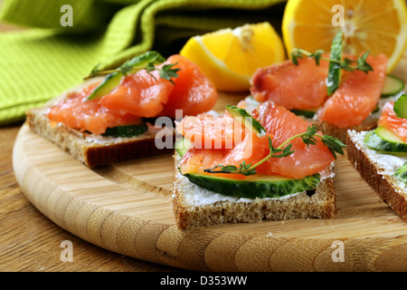 Salmon cucumber food bread stock photos salmon cucumber for Canape sandwiches