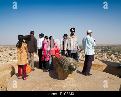 India, Rajasthan, Jaisalmer, Indian tourists enjoying view over city, from Fort Bastion - Stock Image
