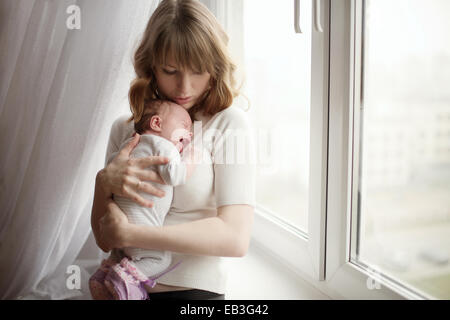 mother-with-cute-little-crying-baby-eb3g