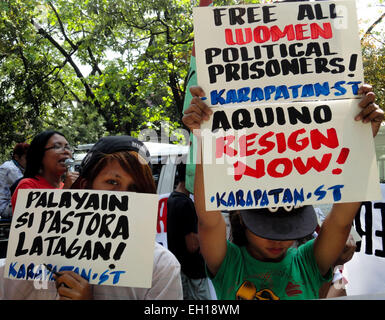 Filipino Activists Display Placards During A Rally In Front Of The  Department Of Justice (DOJ