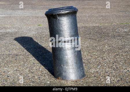 Naval cannon upended and used as bollard, old docks, East India Dock Basin, London - Stock Image