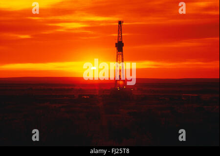 Land based oil rig pictures sunset