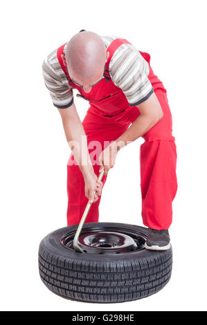 hardworking mechanic changing car wheel tire isolated on white stock image