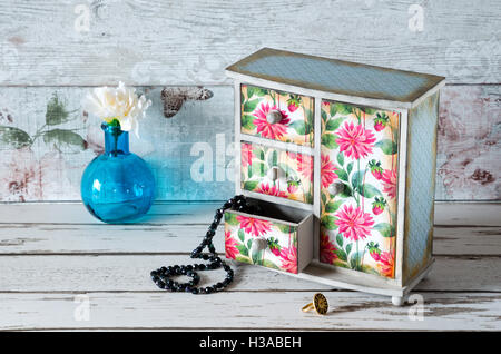 A Hand Made Decoupaged Jewellery Armoire In A Shabby Chic Pink Floral  Design   Stock Image