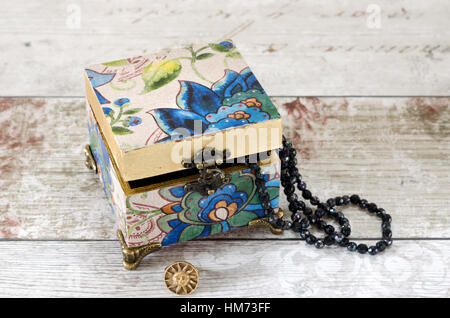 A Gorgeous Hand Made Trinket Box With Bronze Feet And Hasp On A Shabby Chic  Background