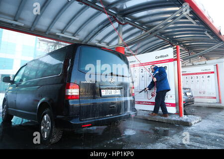 Car wash stock photos car wash stock images alamy a man washes his vehicle at an solutioingenieria Image collections